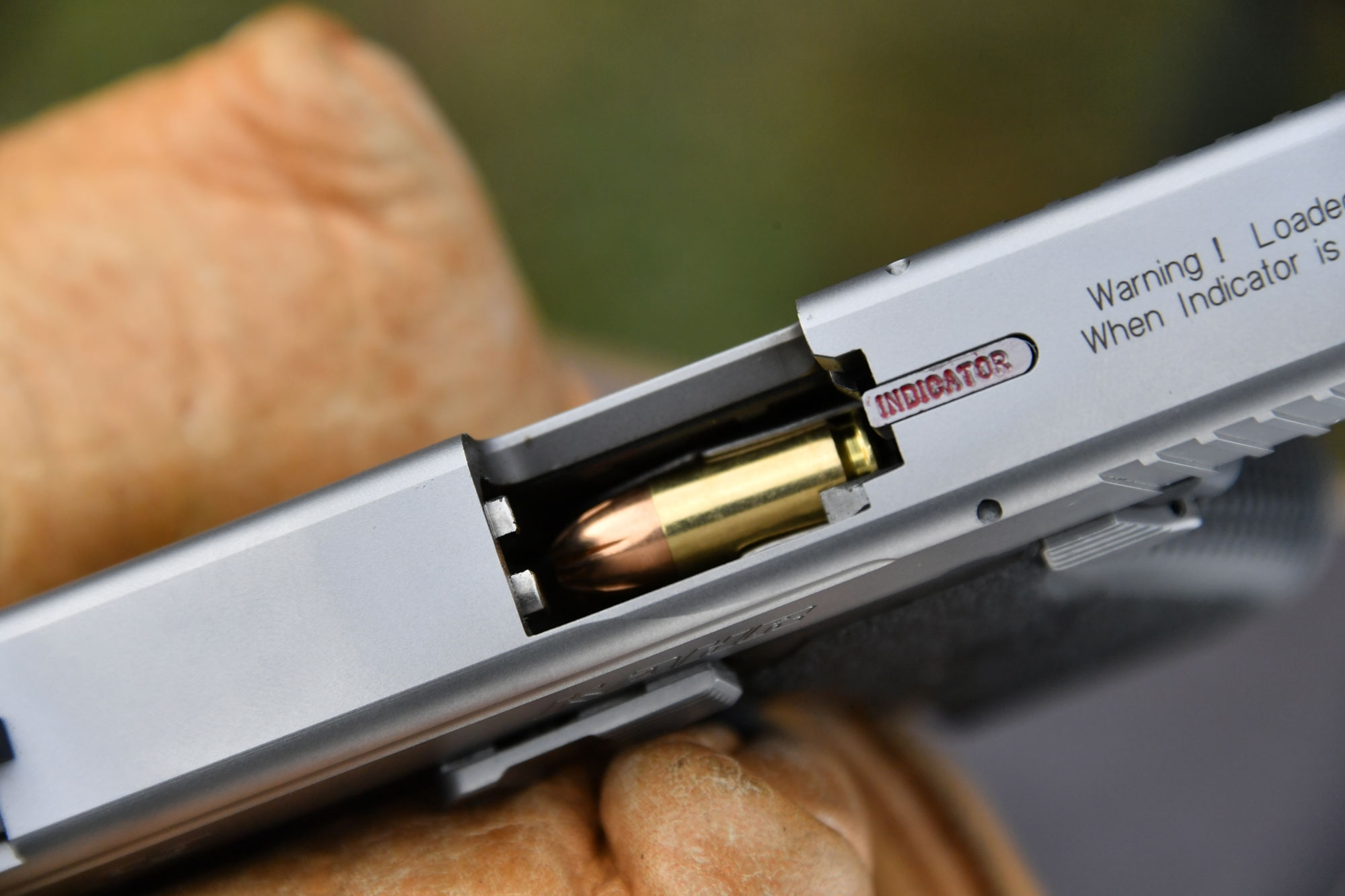 9 mm cartridge in the chamber of the Kahr P9 compact pistol