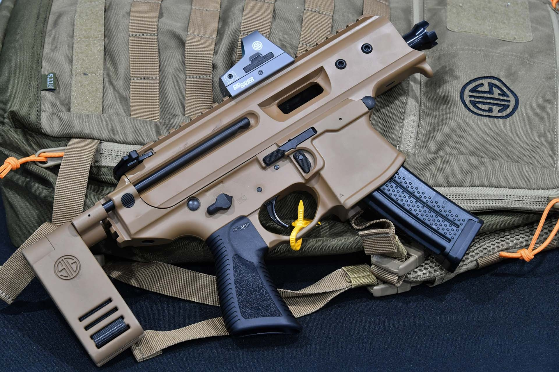 The SIG Sauer MPX Copperhead sub-machine gun with the new SIG SAUER Pivoting Contour Brace (PCB) extended.