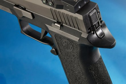 SIG Sauer P320 X-Five from behind with Romeo1 mounted.