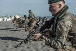 Soldiers with SA80 assault rifle at the beach