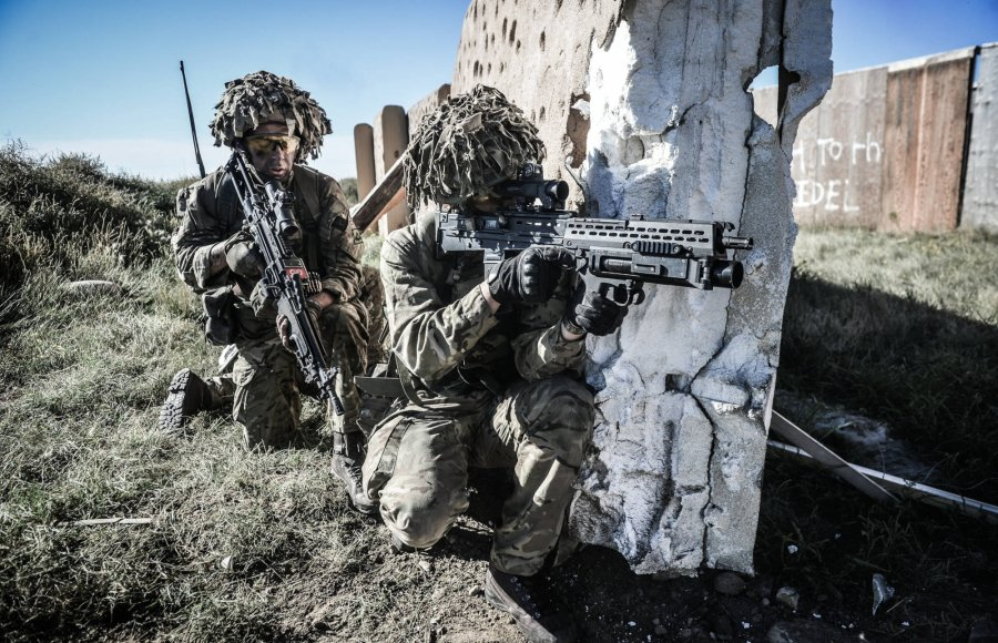 Soldiers with SA80 assault rifle on a wall