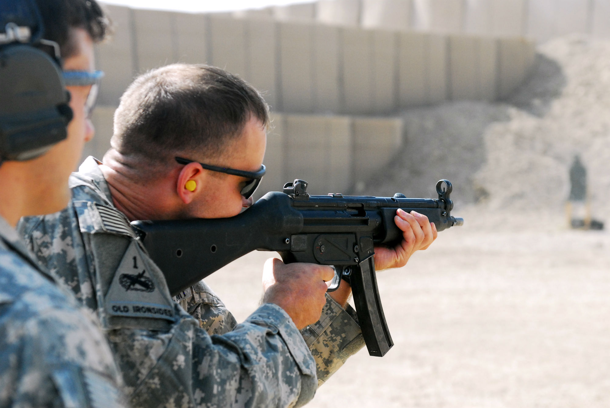 Soldier shooting with the Heckler and Koch MP5s