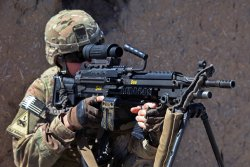 Soldier shooting with the M249 Squad Automatic Weapon