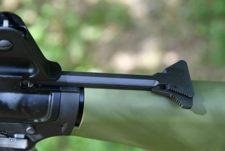 Triangle charging handle on a rifle