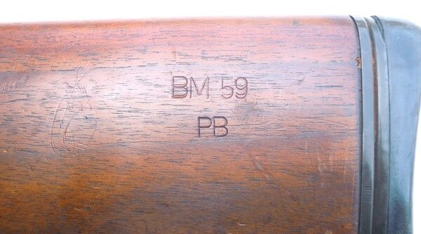 Factory markings on the stock of a Beretta BM59 rifle