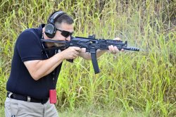 Alessio Carparelli in action with the SAIGA-9.