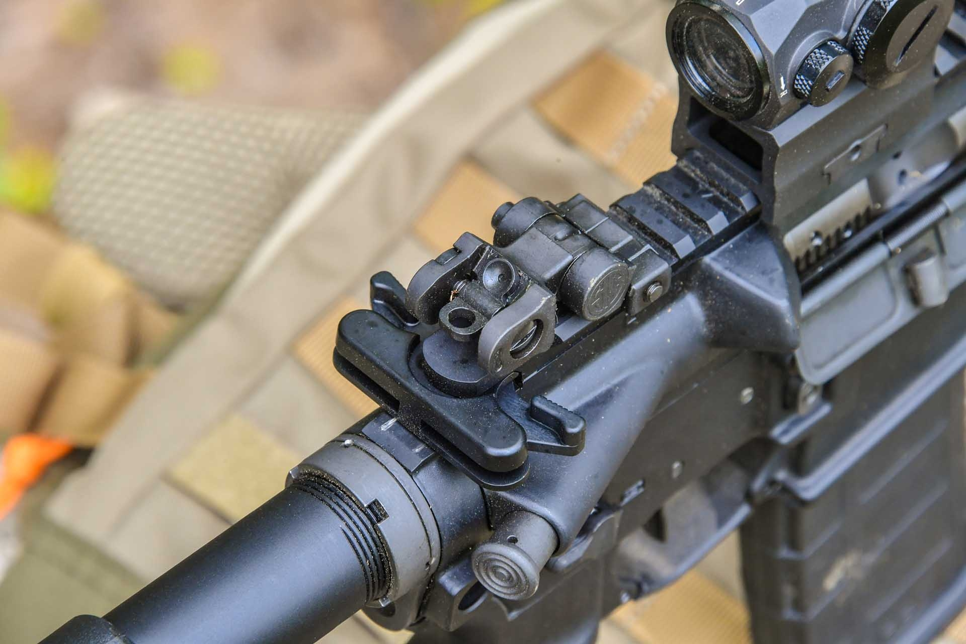 The flip-up rear iron sights of the SIG Sauer M400 TREAD rifle