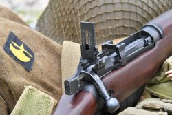 Lee-Enfield No.4 rifle features an adjustable Mk 4 sight with Mk III leaf