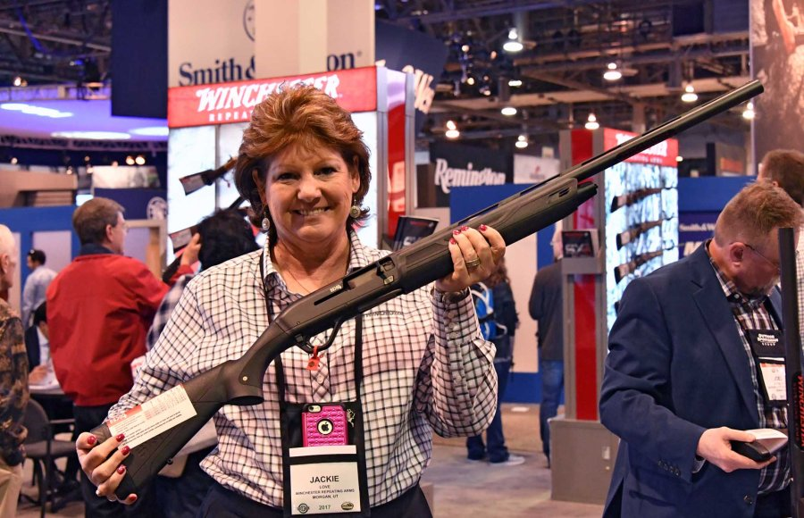 Woman holding the Winchester S X4 at SHOT Show 2017